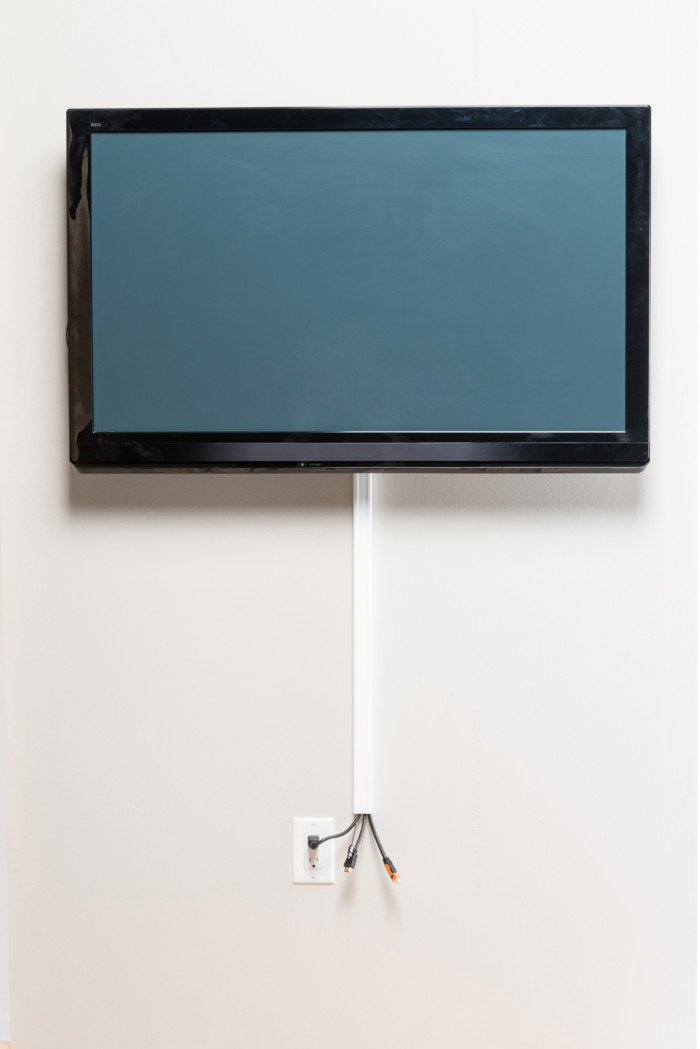Tv mounting with cords concealed on wall with raceway