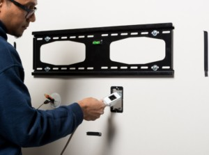 In wall cable management for wall mounted TVs