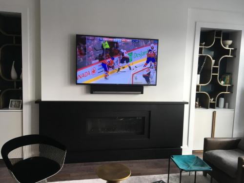 TV Wall Mounting with Soundbar Installation