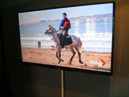 TV Wall Mounting with On-Wall Cord Concealing